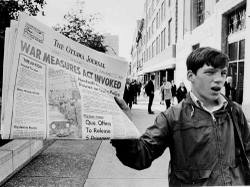 Peter_bregg_a_newsboy_holds_up_a_newspap